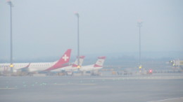 A Helevetic Airways ERJ-175 and two Austrian Airlines Bonbardier Dash-8's at VIE