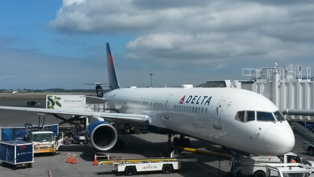 A Delta 757 waits at its gate