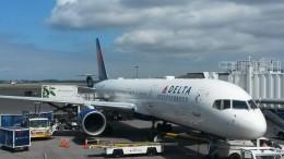 A Delta 757 waits at its gate
