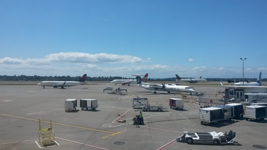 Let's play a little game called Count How Many Planes You Can See! In this shot of the busy ramp at SEA one can make out a Delta Connection E170, a Alaska/Horizon Air Dash 8, a Virgin America A320, and an Alaska/Skywest E170, plus two Delta 757's on the taxiways in the distance