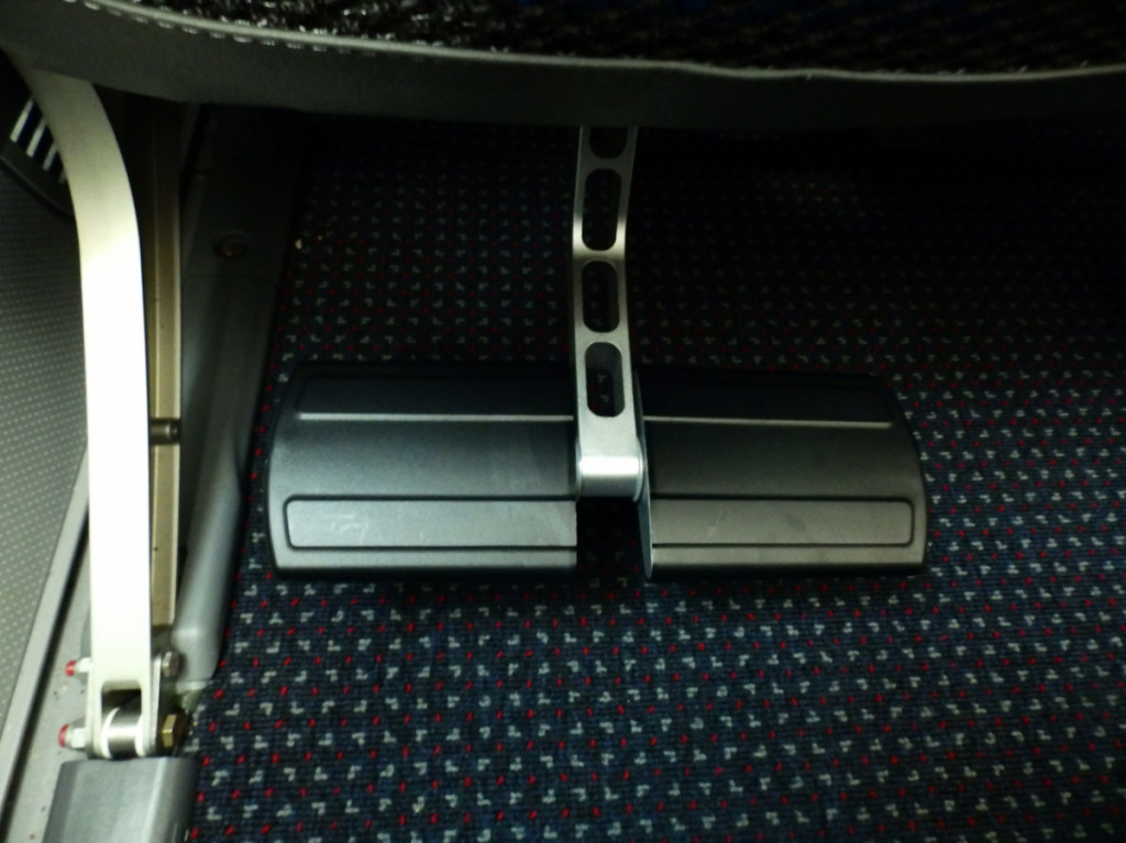 American premium economy footrest in down position -- no leg rests!