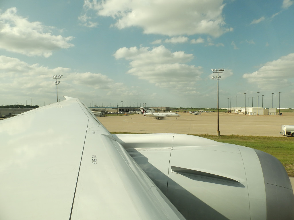 The white aircraft to the right of the wing is a Qatar Airways executive aircraft